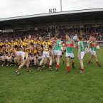 With plenty at stake, tempers become frayed. The Crossmaglen Rangers and Garrycastle players clash as they emerge for the team photographs in Kingspan Breffni Park. The game itself does not develop into a battle. At the second time of asking, Crossmaglen Rangers are far too strong as they rout their opponents by 15 points. (INPHO/Donall Farmer).