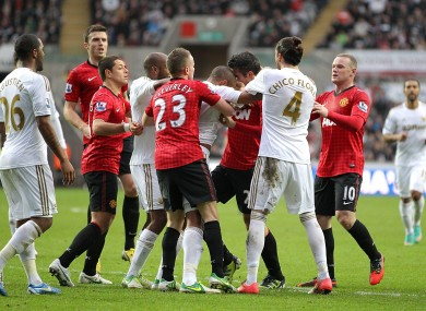 Players scuffle following the incident.