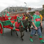 There's plenty colour outside Croke Park before the All-Ireland final. Tom Farrell gets in on the act with his donkey, Daisy Brolly. (INPHO/Morgan Treacy).