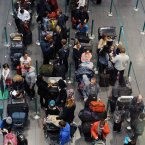 People queue for check in at Terminal 2 in Dublin Airport before returning home after the festive break.