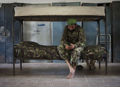 File photo of an Afghan National Army soldier n his bed inside the sleeping quarters of his barracks in Kunduz.