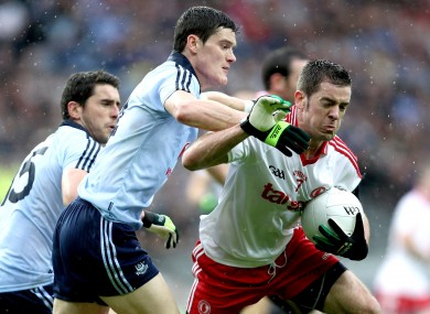 Dublin's Bernard Brogan and Diarmuid Connolly with Philip Jordan of Tyrone.