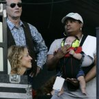 Bill Murray, Sheryl Crow and a baby. (AP Photo/Charles Rex Arbogast)