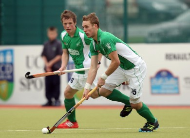 Ames (on the ball) and Sloan in action for Ireland.
