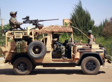 French special forces drive through the city of Gao, Northern Mali, yesterday.