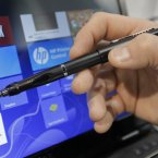 E Fun's Apen Touch8 pen is shown at the International Consumer Electronics Show in Las Vegas. Many people who have tried Microsoft's new Windows 8 operating system without a touch screen have hated it because of the inability to use touch and swipe commands to get things going. Now a company has made a digital pen to allow people to use Windows 8 on their old monitors for less than the cost of buying a new touch-enabled computer. (AP Photo/Jae C. Hong)