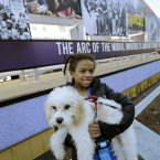 Arianna Dorman of Fort Washington, Md., holds her dog