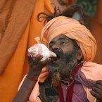 A Hindu holy man drinks the river Ganges water at Sangam, the confluence of rivers Ganges, Yamuna and mythical Saraswati. (AP Photo/Rajesh Kumar Singh)