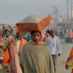A woman Hindu devotee along with arrives at Sangam. (AP Photo /Manish Swarup)