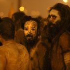 Naked Hindu holy men or a Naga Sadhus return after a dip at Sangam. (AP Photo /Manish Swarup)