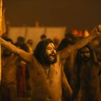 A naked Hindu holy man or a Naga Sadhu shout slogans after a dip at Sangam. (AP Photo /Manish Swarup)