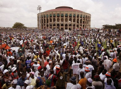 File photo of a political rally at a stadium in Abidjan in 2005. 60 children are reported to have died after a stampede at a stadium in the city.