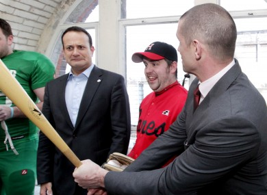 Leo Varadkar meets Munster rugby legend Alan Quinlan (right) and introduces him to the baseball bat of the Dublin City Hurricanes' Peter Kavanagh (centre).