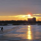 Skaters at a frozen canal as the sun sets near Durgerdam, north of Amsterdam, Netherlands. (AP Photo/Margriet Faber)