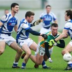 Offaly's Ross Brady under pressure from Brendan Quigley, Paul Begley and Padraig McMahon of Laois. Credit: INPHO/Cathal Noonan