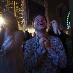 Performers react as fireworks explode over the Singapore financial district. (AP Photo/Wong Maye-E)