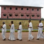 Sri Lankan inmates of the Welikada prison carry statues of Lord Buddha as they take part in a religious ceremony on the eve of new year. (AP Photo/Eranga Jayawardena)
