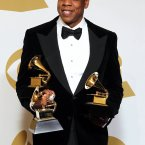 Has anyone ever looked more nonchalant holding a couple of Grammys? 