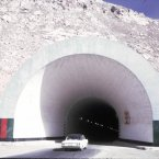A nice car drives through a nice tunnel.