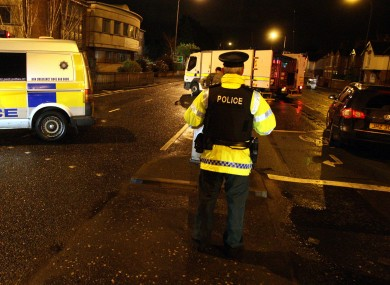 PSNI officers attend the scene at the Upper Newtownards Road on December 30, following the attempted bombing of a PSNI officer's family car.