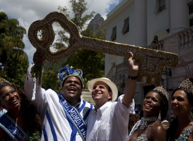 King Momo and Rio de Janeiro's Mayor Eduardo Paes hold up the key of the city to open Carnival.