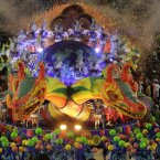 Performers from the Unidos de Vila Isabel samba school parade during carnival celebrations at the Sambadrome(AP Photo/Hassan Ammar).