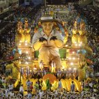 Performers from the Unidos de Vila Isabel samba school parade (AP Photo/Hassan Ammar).