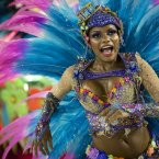 A performer from the Unidos de Vila Isabel samba school parades during Carnival celebrations (AP Photo/Felipe Dana).