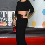 Jessie Ware also wore a long black outfit with gold accents but mixed it up with a birra midriff.  You go Jessie Ware.  Doug Peters/Doug Peters/EMPICS Entertainment