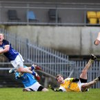 Cavans Cian Mackey is taken down by Antrim goalkeeper Chris Kerr for a Cavan penalty. Pic: INPHO/Presseye/John McIlwaine