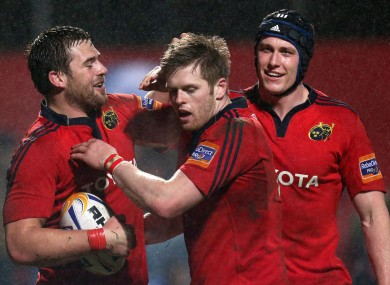 Munster's CJ Sander celebrates his try with Ivan Dineen and Ian Nagle.