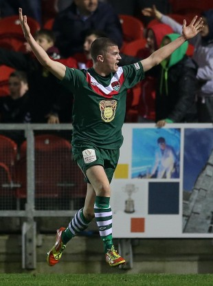City's Danny Morrissey celebrates scoring.