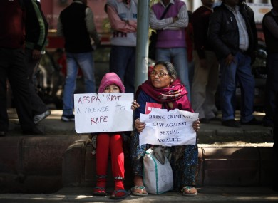 Indian woman and child at protest over India's treatment of violence against women.