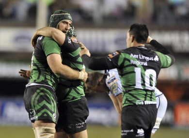 Connacht's John Muldoon celebrates Ethienne Reynecke and Miah Nikora at the final whistle.