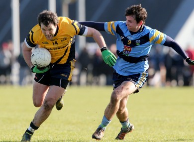 Sigerson row: Murphy, left, tackled by Niall Murray of UCD during Thursday's quarter-final.