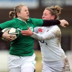 Niamh Briggs, tackled here by Amber Reed, added five points from the boot. INPHO/Dan Sheridan