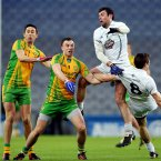 Kildare's Padraig O'Neill and Gary White contest a high ball with Rory Kavanagh and Martin McElhinney of Donegal. Pic: INPHO/Cathal Noonan