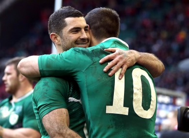 Rob Kearney hugs Jonny Sexton after the 30-22 win.