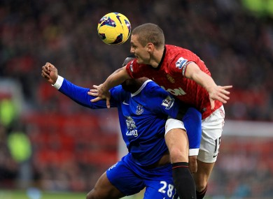 Everton's Victor Anichebe (left) and Manchester United's Nemanja Vidic (right) battle for the ball.