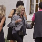 June Steenkamp, centre, the mother of Reeva Steenkamp, arrives for her funeral in Port Elizabeth. (AP Photo/Schalk van Zuydam)