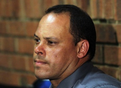 Investigating officer Hilton Botha, sits inside the court witness box during the Oscar Pistorius bail hearing.