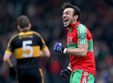Ballymun's Ted Furman celebrates at the final whistle. 