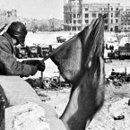 The Red Flag flies over the battered ruins of Stalingrad.