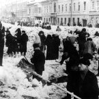 Weakened by hunger and cold, men and women work slowly to clear snow blocking Nevsky Prospect, Leningrad's main street, during the winter of 1941-42. Many workers could hardly lift the shovels. As they turned over the snow, they found many bodies of people who had died of starvation in this first winter of German soldier's' siege of the city. It was the coldest winter in a half century, with temperatures falling to 22 below zero (fahrenheit).