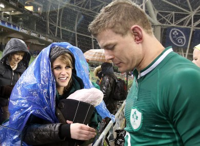 Amy Huberman and baby Sadie greet O'Driscoll after the match.