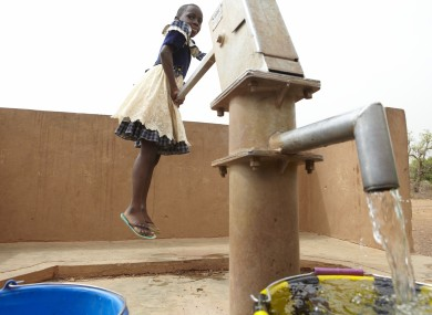 	Jessica Batoure fetches water for her class in Soanga school, north central Burkina Faso.