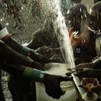 Children play in the borehole fresh water as it is sprayed from a pipe in the village of Nawoyatir in the Lapur district of Lokitaung in Turkana.