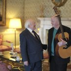 President Higgins chats to Christy Moore in ras an Uachtarin at the filming of 'Glaoch - The President's Call'.