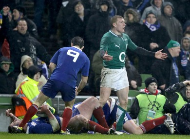 Keith Earls protests to Steve Walsh after Vincent Debaty's tackle.
