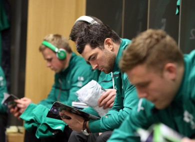 Rob Kearney reads a match programme before Ireland v France.
